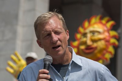 Billionaire environmental activist Tom Steyer, pictured here addressing the March to Break Free from Fossil Fuels in 2016 in Los Angeles, has launched an ad campaign seeking President Trump's impeachment. (David McNew/AFP/Getty Images)