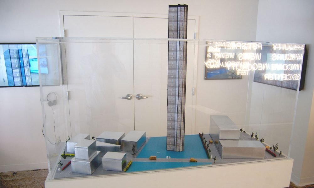 "A model of Pat Falco's proposed ""Luxury Waters"" condo tower. (Greg Cook/WBUR)"