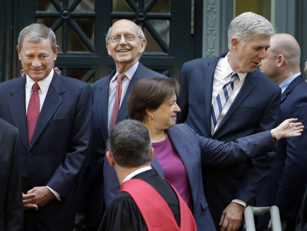 United States Supreme Court Chief Justice John Roberts, left, and Associate Justices Anthony Kennedy, second from left, Neil Gorsuch, right, and Elena Kagan, front, stand together Thursday, Oct. 26, 2017, at Harvard Law School on the campus of Harvard University, in Cambridge, Mass. The justices were on campus to open a bicentennial summit for the law school. (Steven Senne/AP)