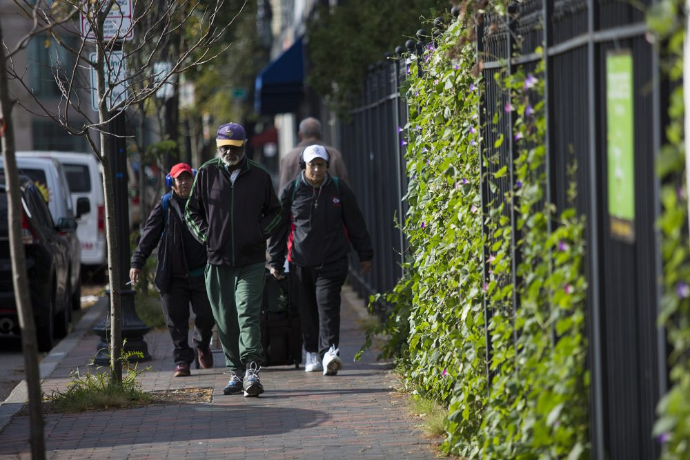 Pedestrians walk up Washington Street in Dudley Square. (Jesse Costa/WBUR)