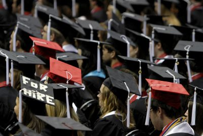Students attend graduation ceremonies. (AP Photo/Butch Dill)