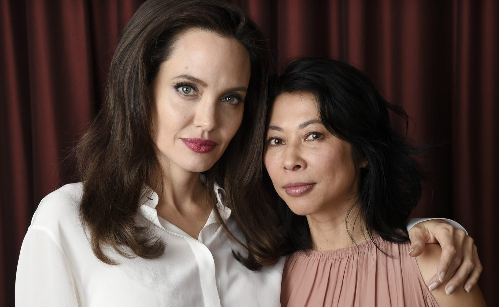 "Angelina Jolie, left, director/co-writer of the film ""First They Killed My Father: A Daughter of Cambodia Remembers,"" and co-writer/human rights activist Loung Ung pose for a portrait during the Toronto International Film Festival in Toronto. (Chris Pizzello/Invision/AP)"
