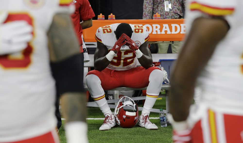 Kansas City Chiefs linebacker Tanoh Kpassagnon (92) sits on the bench during the national anthem before an NFL football game against the Houston Texans, Sunday, Oct. 8, 2017, in Houston. (David J. Phillip/AP)
