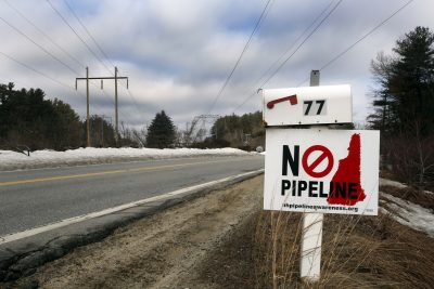 In this 2015 photo, residents in Windham, N.H. show their disapproval of a proposed natural gas pipeline plan along an existing power line corridor. (Jim Cole/AP)