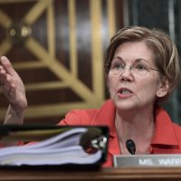 Sen. Elizabeth Warren, D-Mass., questions Wells Fargo Chief Executive Officer and President Timothy Sloan as he testifies before the Senate Committee on Banking, Housing and Urban Affairs on Capitol Hill in Washington, Tuesday, Oct. 3, 2017.  (Susan Walsh/AP)
