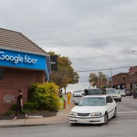 In 2010, cities like Kansas City bid to be the first to test Google Fiber, a new internet and TV service that promised unmatched download and streaming speeds. (Dean Russell/Here & Now)