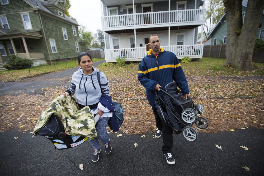 Alicea and Santini walk outside their apartment in Greenfield on their way to Enlace de Familias.. (Jesse Costa/WBUR)