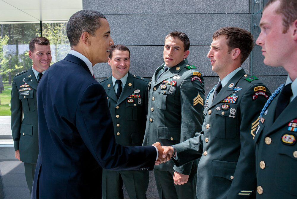President Obama greets Cory Remsburg and other Army Rangers in Normandy on June 6, 2009. (Courtesy of Little, Brown and Company/Pete Souza)