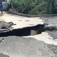 1st Lt. Erin Graham of the North Carolina National Guard inspects a washed out bridge in the small Puerto Rico community of Vallaja. (Jay Price/WUNC)