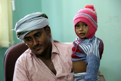 A Yemeni father carries his child, suspected of being infected with cholera, as he waits to be seen at a hospital in the Yemeni coastal city of Hodeidah on Nov. 5, 2017. (Abdo Hyder/AFP/Getty Images)