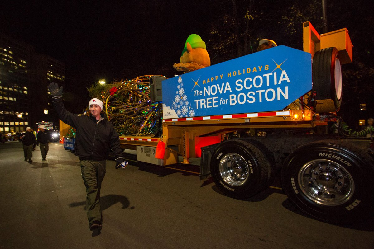 The Christmas tree sent from Nova Scotia to Boston to thank it for its role in helping after a deadly explosion 100 years ago rolls into Amherst, Nova Scotia. (Courtesy Photo @TreeForBoston)
