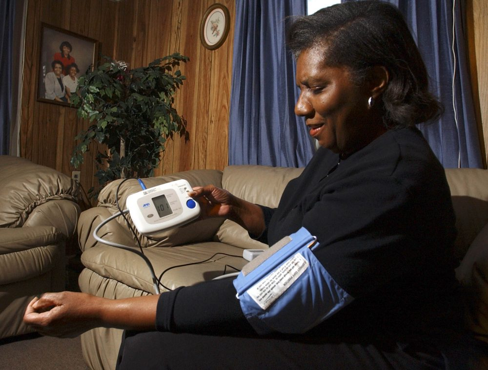 Doris Smith of Snow Hill, Ala., checks her blood pressure at her home. (Dave Martin/AP)
