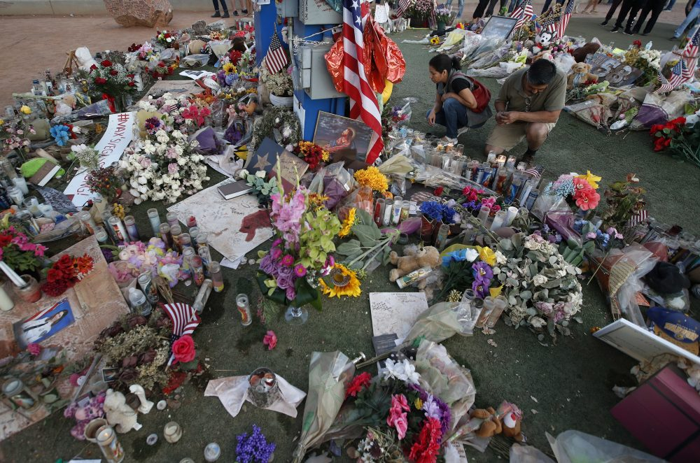 People visit a makeshift memorial for victims of the mass shooting in Las Vegas, Monday, Oct. 16, 2017. (John Locher/AP)