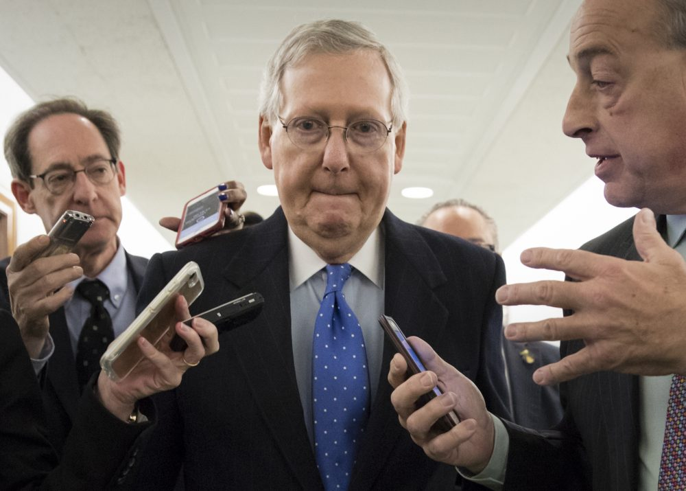 Senate Majority Leader Mitch McConnell, R-Ky., is surrounded by reporters as Republicans work to pass their sweeping tax bill, on Capitol Hill in Washington, Thursday, Nov. 30, 2017. (J. Scott Applewhite/AP)