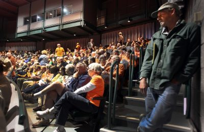 Back in 2013, hundreds of people fill the Hanaway Theatre at Plymouth State University during a public hearing before the U.S. Department of Energy on the Northern Pass project.  (Jim Cole/AP)
