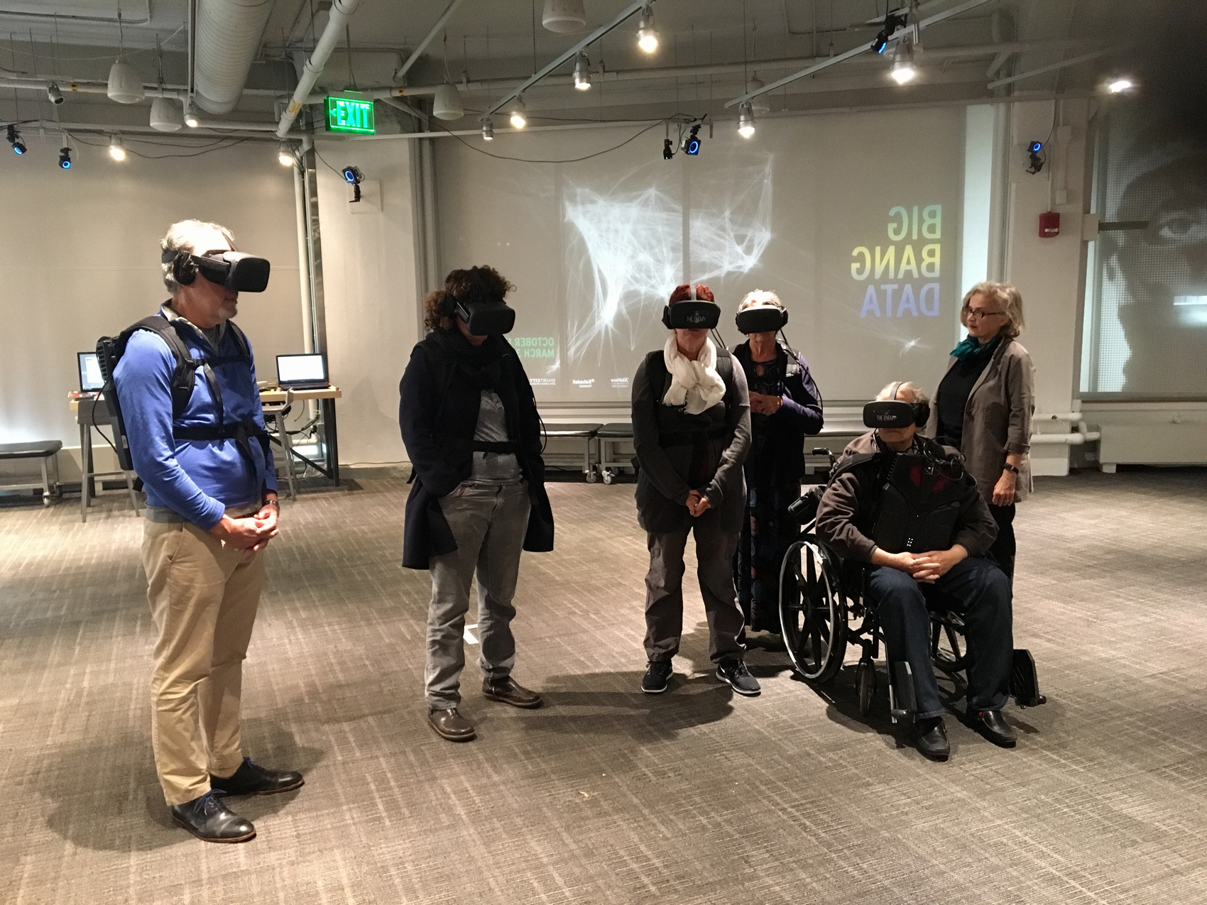 "MIT Museum visitors use virtual-reality gear to experience ""The Enemy,"" Karim Ben Khelifa's exploration of conflict zones and the people who inhabit them. (Courtesy MIT Museum)"