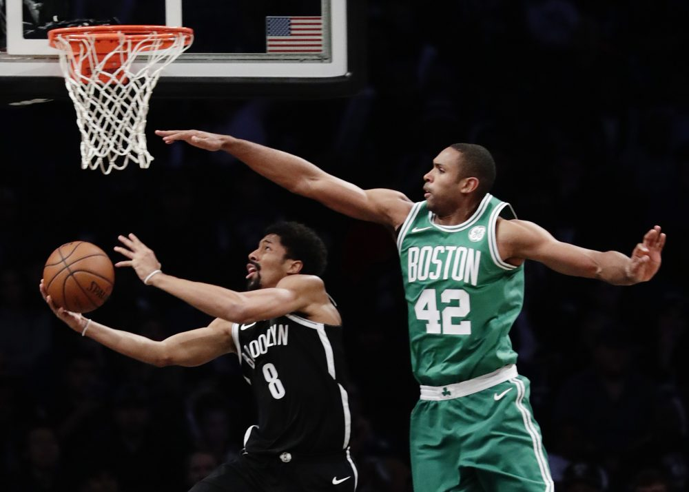 Brooklyn Nets' Spencer Dinwiddie (8) drives past Boston Celtics' Al Horford (42) during the second half of an NBA basketball game Tuesday, Nov. 14, 2017, in New York. The Celtics won 109-102. (AP Photo/Frank Franklin II)