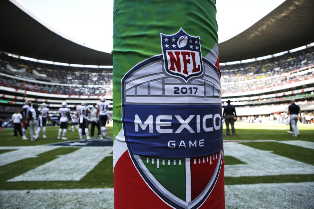 The logo for the NFL's Mexico Game is displayed on a goal post pad during warmups before an NFL football game between the Oakland Raiders and the New England Patriots, Sunday, Nov. 19, 2017, in Mexico City. (AP Photo/Rebecca Blackwell)