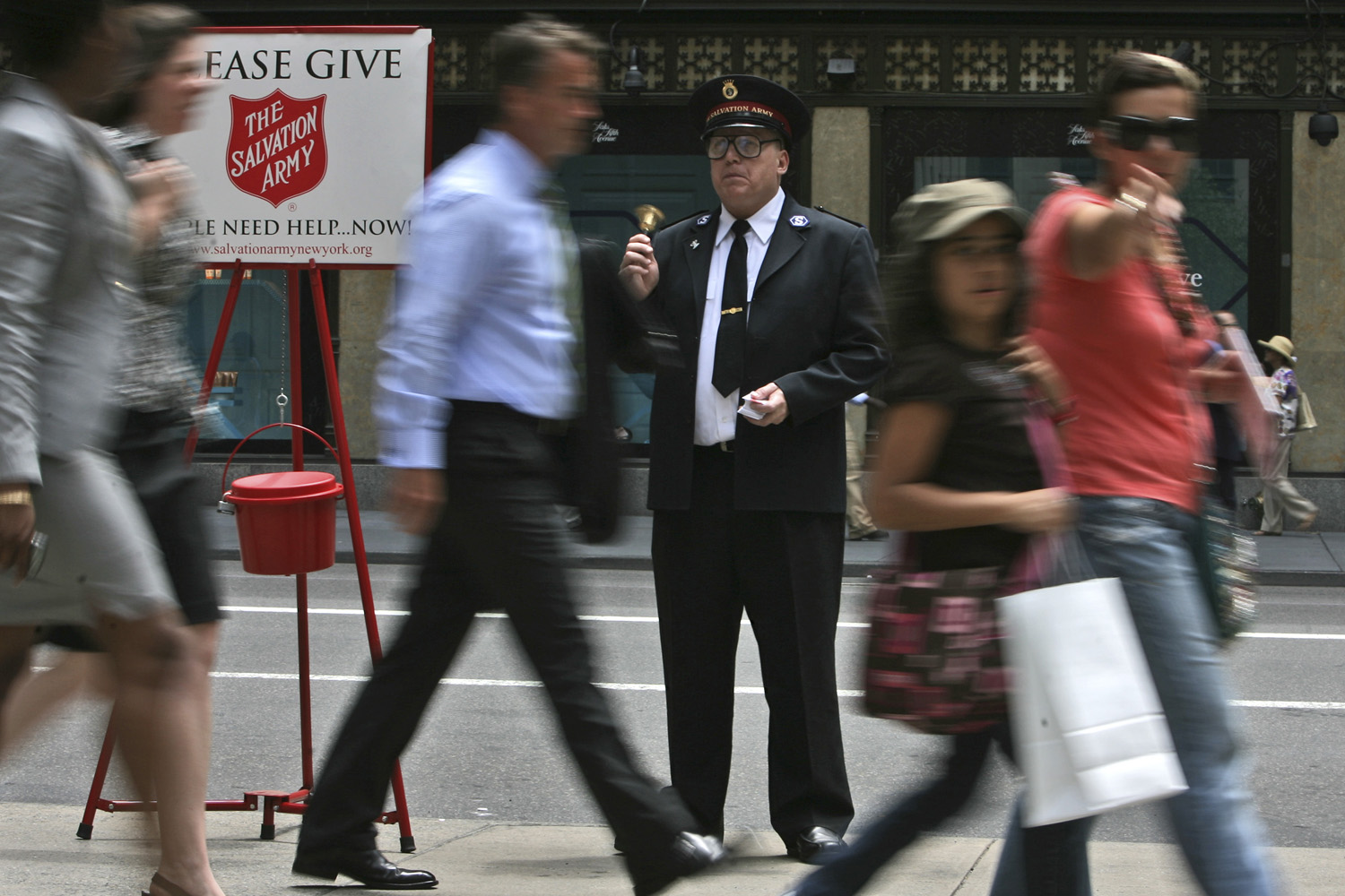Salvation Army Soldier Daniel Aherns collects donations on 5th Ave. at Rockefeller Center, Monday, July 13, 2009 in New York.