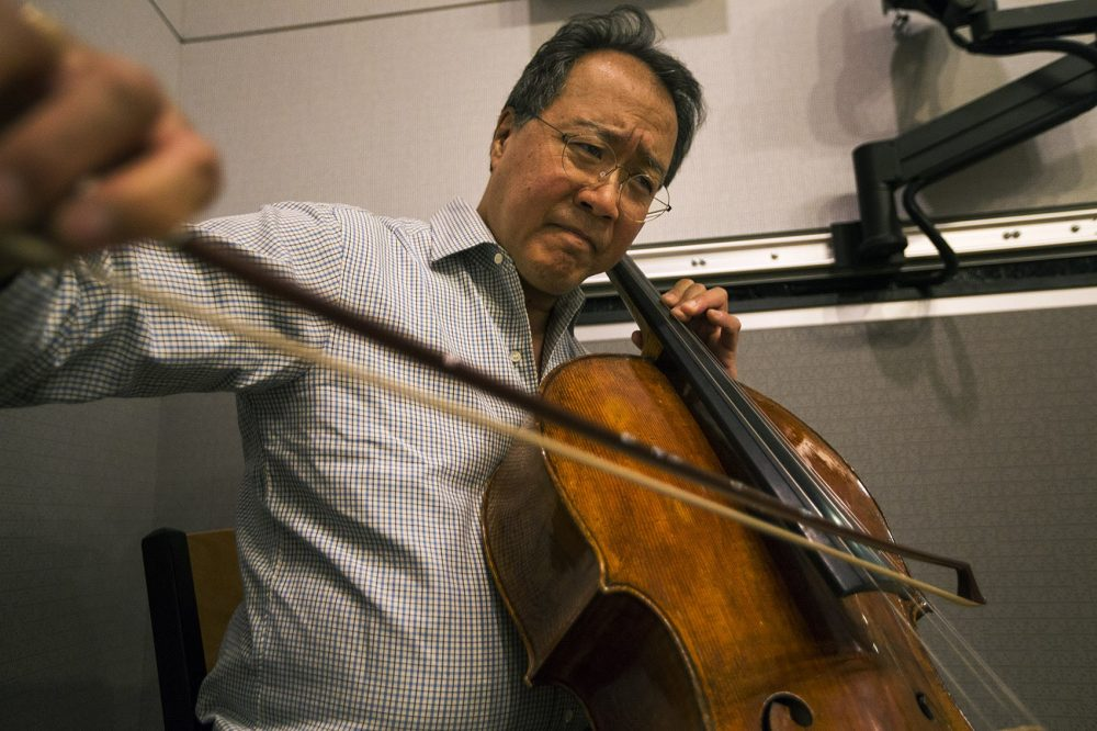 Yo-Yo Ma playing with Chris Thile and Edgar Meyer in the WBUR studios. (Jesse Costa/WBUR)