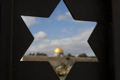 The Dome of the Rock Mosque in the Al Aqsa Mosque compound in Jerusalem's Old City is seen trough a door with the shape of star of David, Thursday, Dec. 7, 2017, a day after President Trump's recognition of Jerusalem as Israel's capital. (Ariel Schalit/AP)