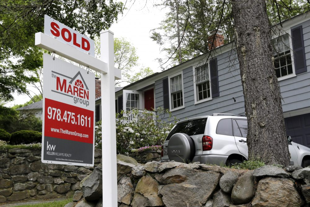 "In this May 24, 2016 file photo, a ""Sold"" sign is placed front of a house in Andover, Mass. (Elise Amendola/AP)"