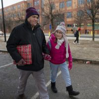 Ten-year-old Mellanie is thrilled to be walking home from school with her father, Francisco Rodriguez. He was released Thursday from detention by immigration officials, where he was held since July. (Jesse Costa/WBUR)