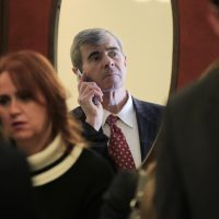 Massachusetts Secretary of State William Galvin peers through the door into the Massachusetts Senate Chambers prior to the swearing in of new members at the Statehouse in Boston in 2011. (Charles Krupa/AP)