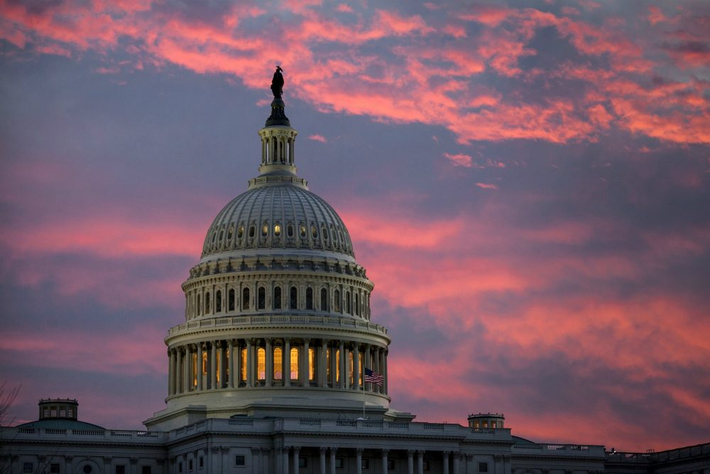 The Capitol is seen at dawn as Senate Republicans work to pass their sweeping tax bill this week, in Washington, Thursday, Nov. 30, 2017. (J. Scott Applewhite/AP)