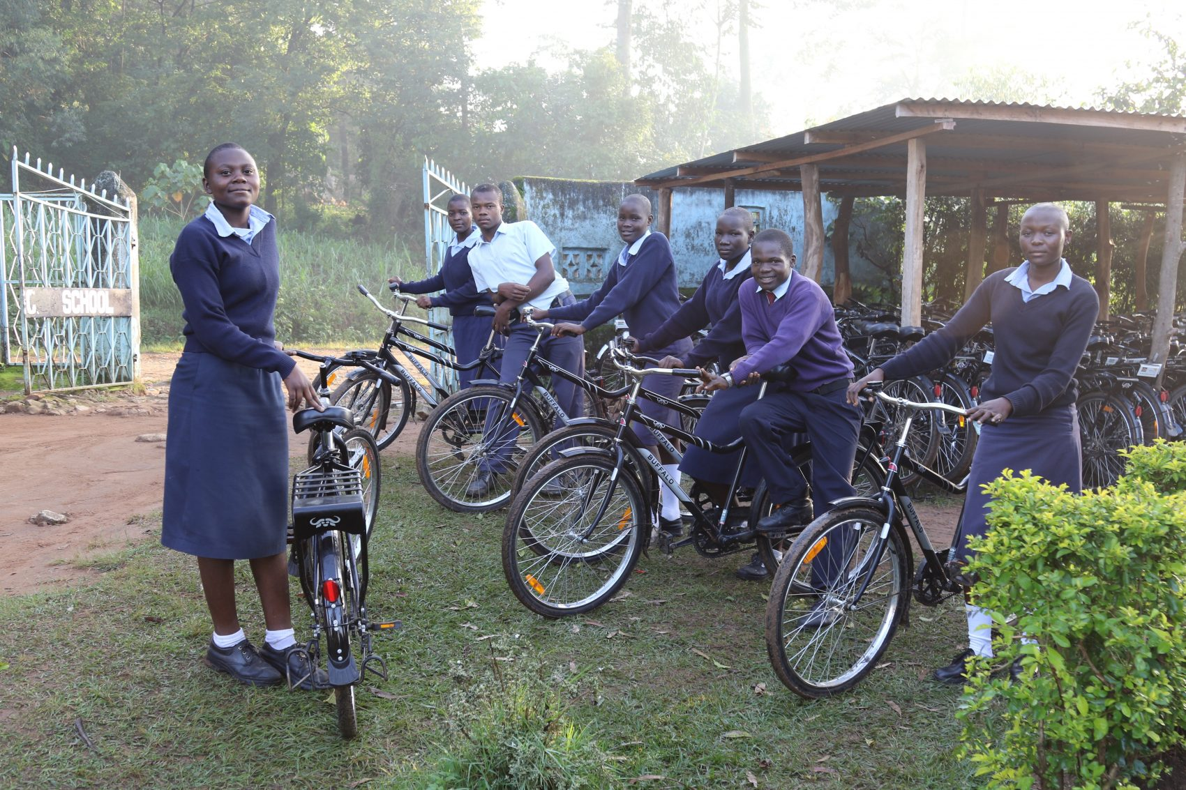 Angela (left) and other students at Bukhaywa Secondary School. (Courtesy World Bicycle Relief)