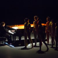 Simone Dinnerstein on piano with dancers Melissa Toogood, Lindsey Jones, Maggie Cloud, Netta Yerushalmy, Maile Okamura, Christine Flores and Jason Collins. (Courtesy Marina Levitskaya)