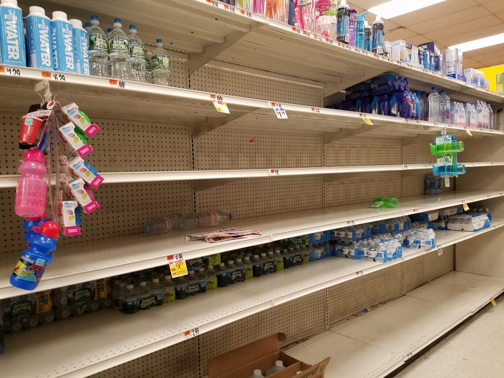 On Wednesday night, Stop & Shop customers in South Boston stocked up on water to prepare for Thursday's storm. In Brookline's Coolidge Corner, nearly all milk and egg products were gone Wednesday night, and many other shelves were bare. (Rachel Paiste/WBUR)
