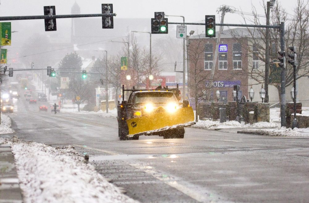 Snowplows are getting in place as the snowfall becomes heavier in Boston. (Robin Lubbock/WBUR)