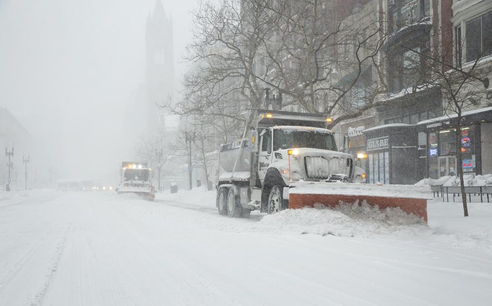 Snow plows clear Boylston Street at the height of the storm. (Robin Lubbock/WBUR)