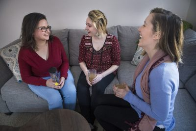 Young cancer survivors, from left to right: Cynthia Fernandez, Kelly and Christina (Jesse Costa/WBUR)