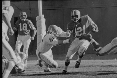 Gene Mingo (center), pictured here in 1962 on the Denver Broncos, quit football just over a week after he began playing as a kid. But he found his way back to the sport, which would impact his life in as many ways off the field as it would on the field. (Courtesy Denver Broncos)