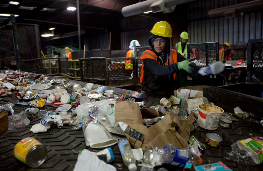 Workers sort paper and plastic waste at Far West Recycling Oct. 30, 2017 in Hillsboro, Ore. China has sharply restricted imports on recycled materials, and the impact will be felt across the Pacific Northwest. (Natalie Behring/Getty Images)