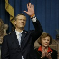 Gov. Charlie Baker waves to those in attendance before he delivers his State of the Commonwealth address in the Massachusetts House Chamber on Tuesday in Boston. (Stephan Savoia/AP)