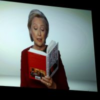 "Hillary Clinton appears on screen reading an excerpt from the book ""Fire and Fury"" during a skit at the 60th annual Grammy Awards at Madison Square Garden on Sunday, Jan. 28, 2018, in New York. (Matt Sayles/Invision/AP)"