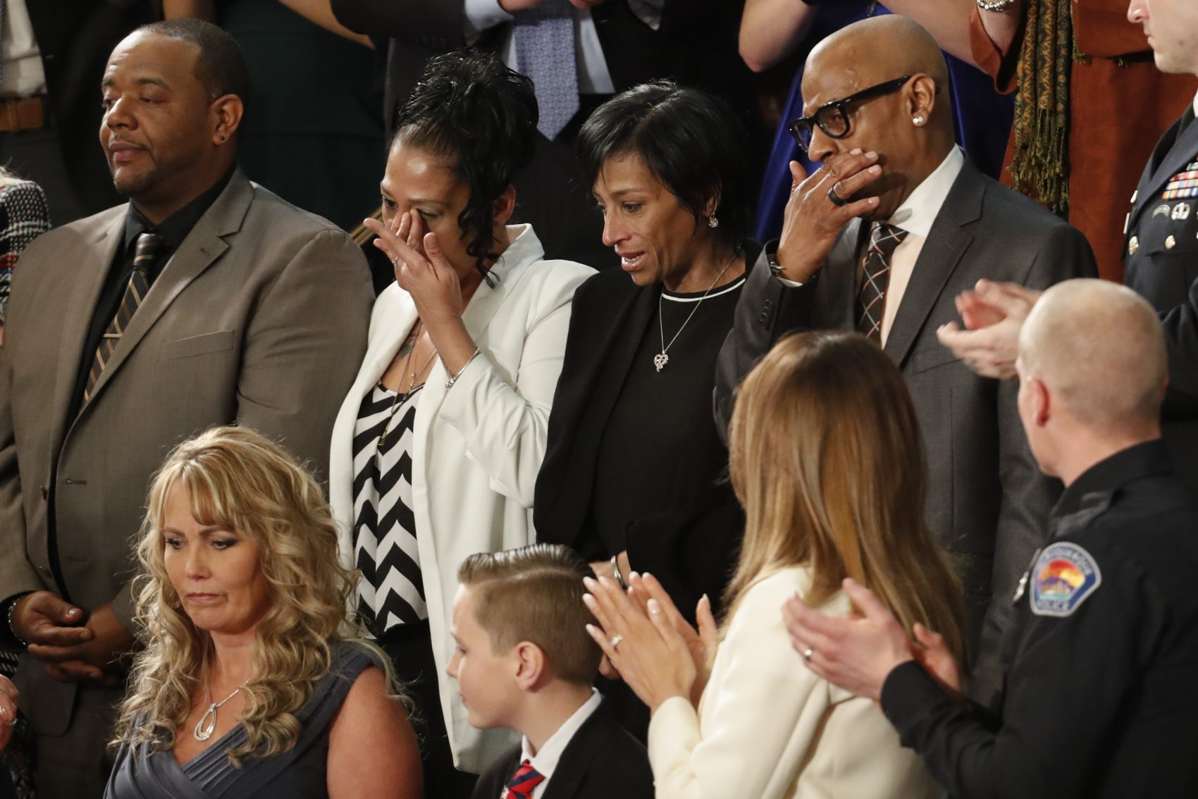 From top left, Robert Mickens, Elizabeth Alvarado, Evelyn Rodriguez, Freddy Cuevas, parents of two Long Island teenagers who were believed to have been killed by MS-13 gang members, during the State of the Union address. (Pablo Martinez Monsivais/AP)