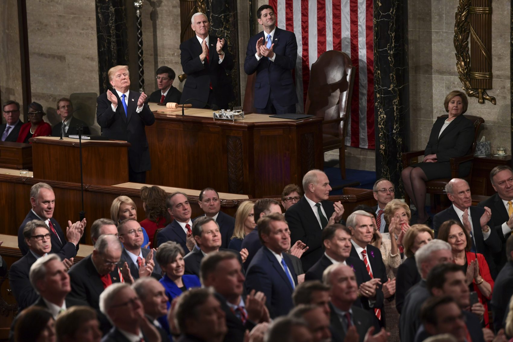 President Donald Trump leads applause for guests in the first lady's box during the State of the Union address to a joint session of Congress on Capitol Hill in Washington, Tuesday, Jan. 30, 2018. (Susan Walsh/AP)