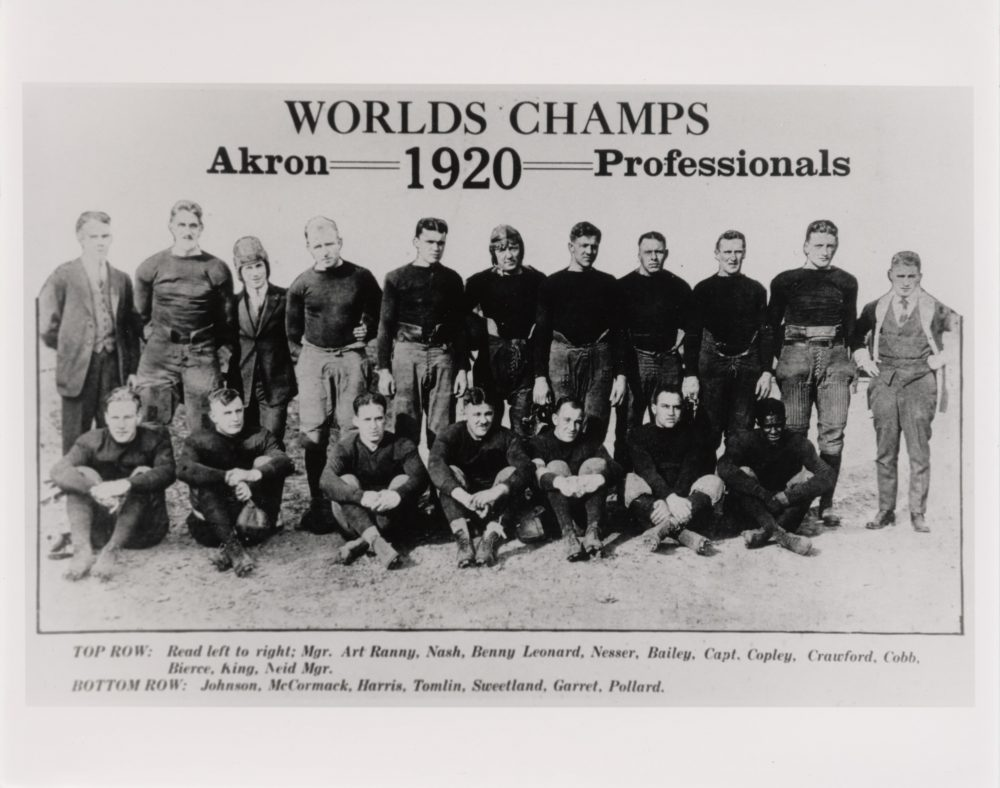 In 1920, the Akron Pros became the first pro football champs. Fritz Pollard is seated, lower right. (John Hay Library, Brown University)