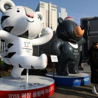Pedestrians walk past mascots of the 2018 PyeongChang Winter Olympic and Paralympic Games in Seoul, South Korea. North Korea will march with South Korea in the Winter Olympics opening ceremonies.  (Chung Sung-Jun/Getty Images)