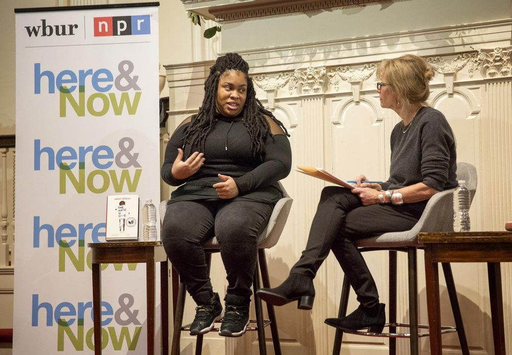 Author Angie Thomas talks with WBUR's Robin Young at the First Parish Church in Cambridge. (Robin Lubbock/WBUR)