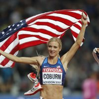 United States' Emma Coburn celebrates after winning the gold medal in the women's 3000m steeplechase final during the World Athletics Championships in London Friday, Aug. 11, 2017. (Frank Augstein/AP)