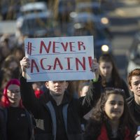 Somerville High School students march down Cedar Street toward Trum Field. (Jesse Costa/WBUR)