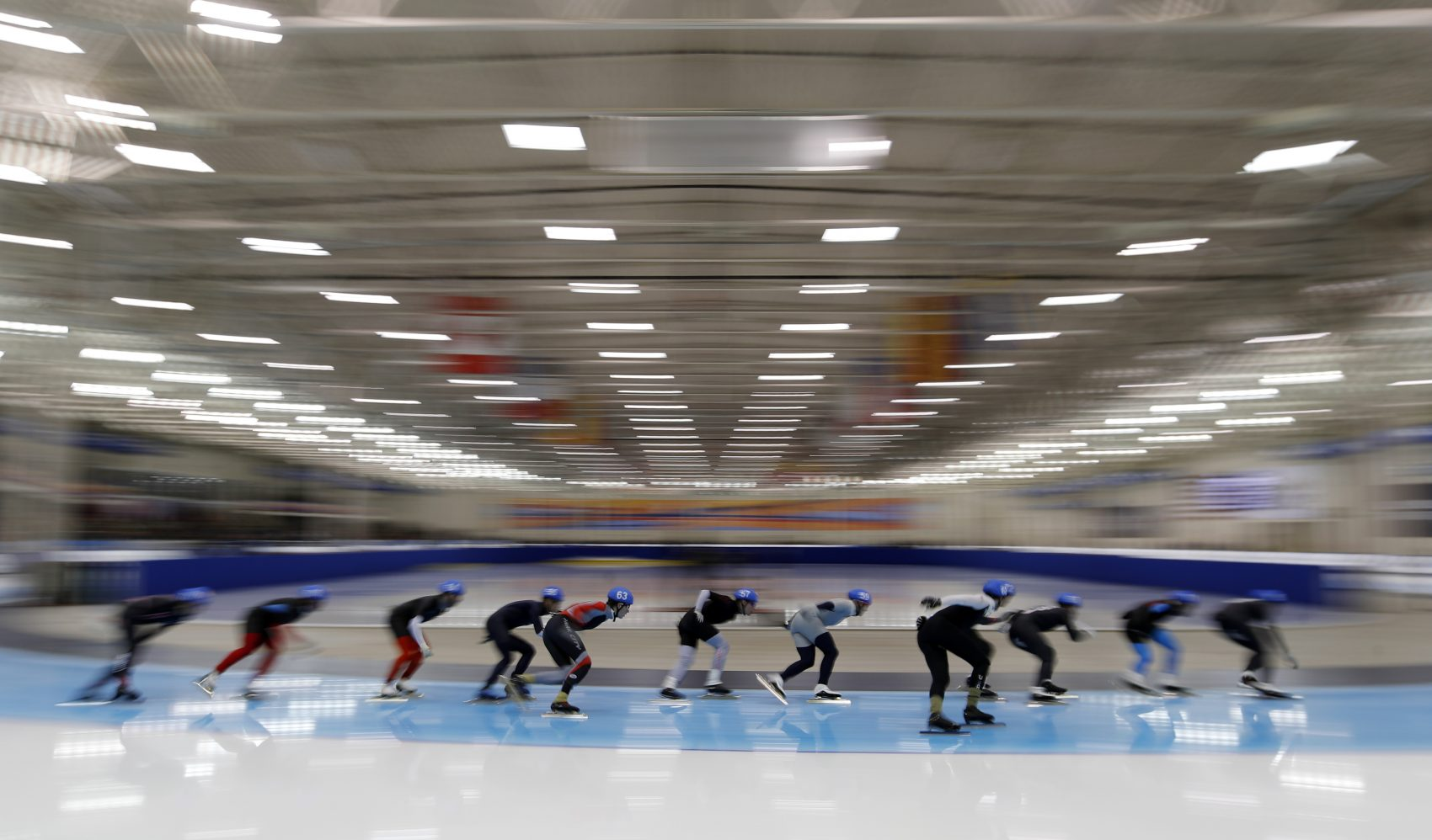 Skaters compete in the men's mass start race during the U.S. Olympic long track speedskating trials, Sunday, Jan. 7, 2018, in Milwaukee. (John Locher/AP)