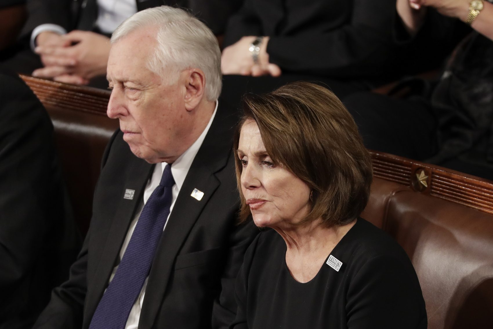 House Minority Leader Nancy Pelosi of California and Minority Whip Steny Hoyer, D-Md., listen to the State of the Union address to a joint session of Congress on Capitol Hill in Washington, Tuesday, Jan. 30, 2018. (J. Scott Applewhite/AP)