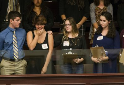 Sheryl Acquarola, a 16-year-old junior from Marjory Stoneman Douglas High School, is overcome with emotion in the gallery of the House of Representatives after the representatives voted not to hear the bill banning assault rifles and large capacity magazines at the Florida Capital in Tallahassee, Fla., Tuesday, Feb 20, 2018. Acquarola was one of the survivors of the Marjory Stoneman Douglas High School shooting that left 17 dead, who were in Tallahassee channeling their anger and sadness into action. (Mark Wallheiser/AP)