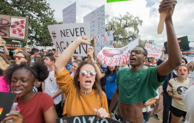 Therese Gachnauer, center, a 18 year old senior from Chiles High School and Kwane Gatlin, right, a 19 year old senior from Lincoln High School, both in Tallahassee, join fellow students protesting gun violence on the steps of the old Florida Capitol in Tallahassee, Fla., Wednesday, Feb. 21. (Mark Wallheiser/AP)